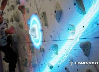 girl climbing valo motion augmented climbing wall