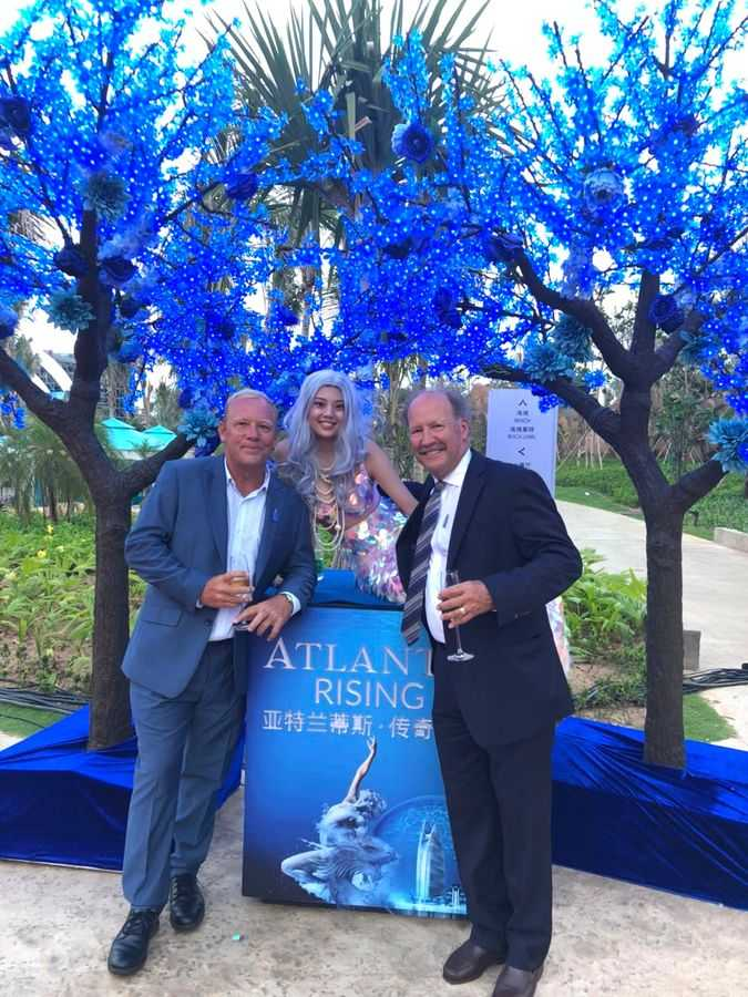 Alan Mahony (left) with ProSlide's Rick Hunter and mermaid friend at Atlantis Sanya