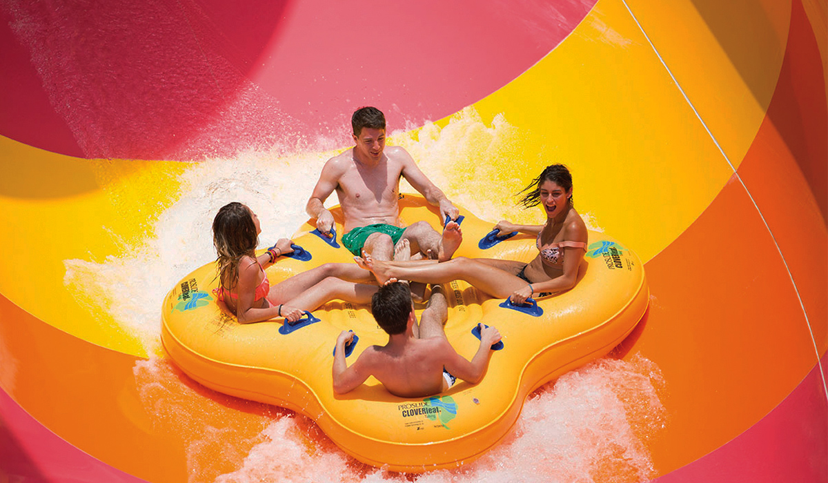Close-up of four riders on a yellow raft