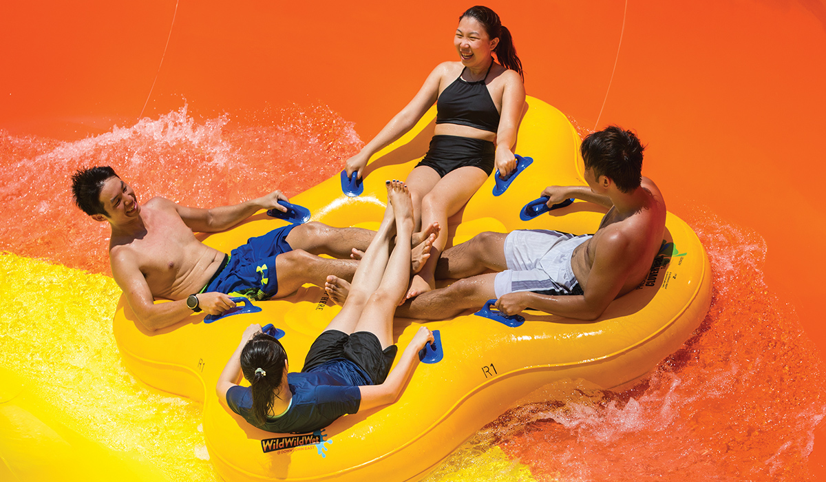 Close up view of four riders in a clover leaf raft