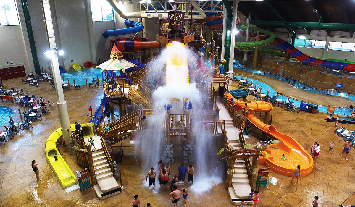 Landscape image of a large indoor family play structure