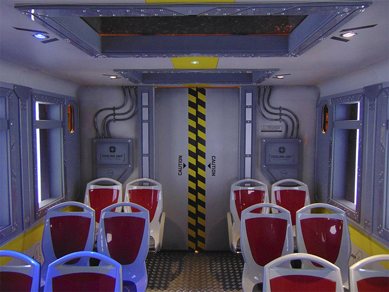 Inside Simworx Immersive Adventurer Ride with red seats and steel aesthetic