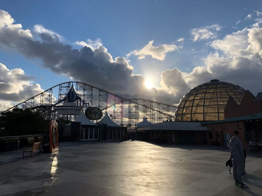 Sun peeking out behind clouds at Blackpool Pleasure Beach