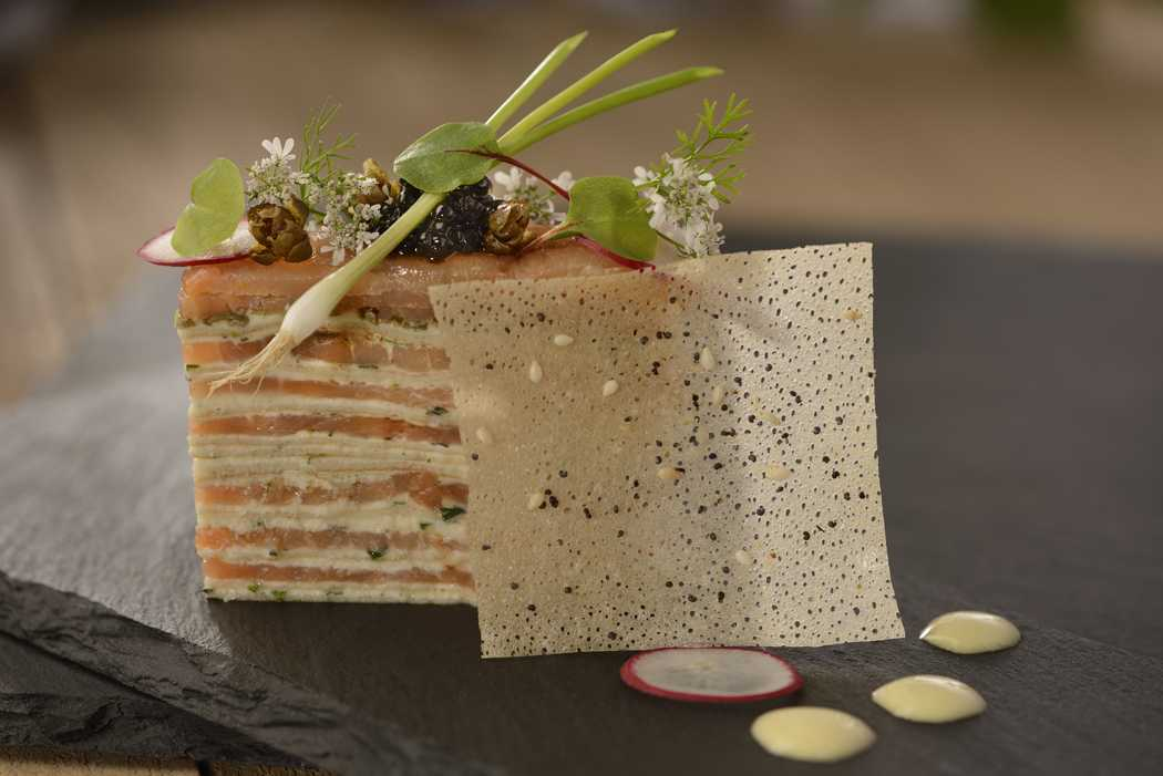 Smoked Salmon and Cream Gâteau with Egg Yolk Cream, Paddlefish Caviar, and Micro-herbs at Painter's Palate at Epcot International Festival of the Arts