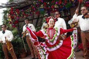 Epcot World Showcase, Epcot International Festival of the Holidays Dancer with Mariachi band seasonal festivals