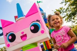 Young girl poses with Unikitty lego at Legoland Florida