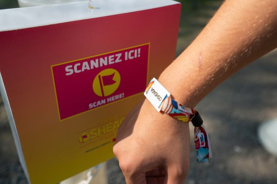 Osheaga Music and Arts Festival guest scanning Connect&GO's RFID wristband at an access point