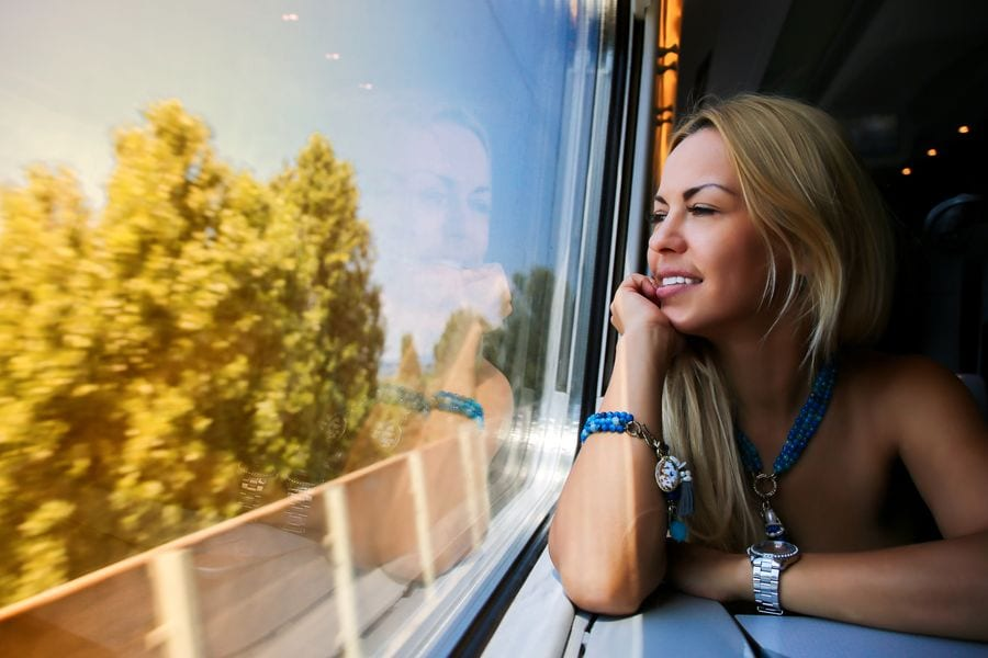 Woman looking at the passing scenery on a moving train