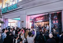 The Shanghai Dungeon at Mosaic mall with actors standing at the entrance and people taking pictures
