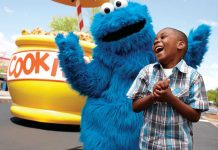 Parade Cookie Monster takes a photo with a laughing boy