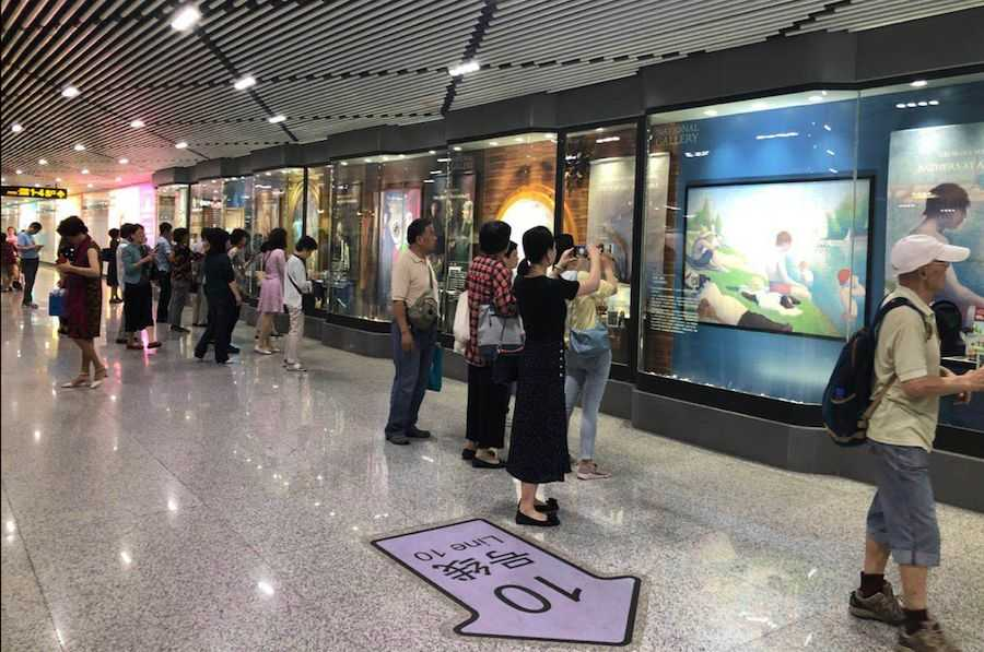 National Gallery Shanghai Metro commuters browsing the exhibition