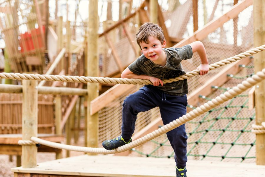 BeWILDerwood child playing at Towering Treetop Tangles