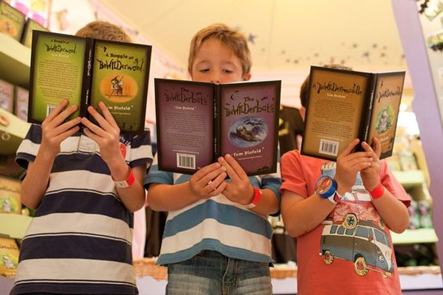 Children reading the BeWILDerwood books