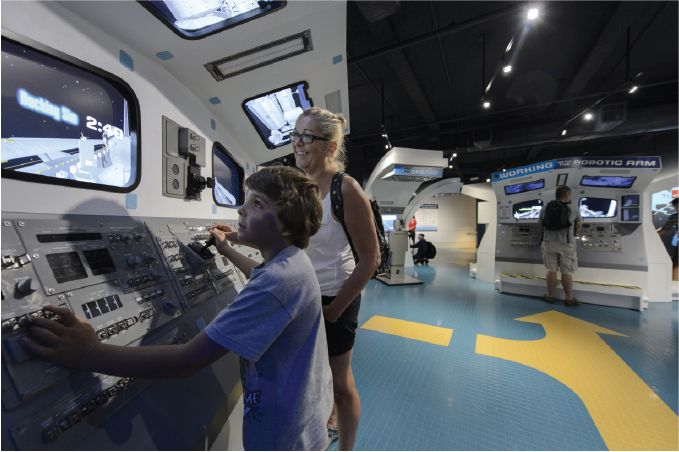 Lexington Companies of Nassal Space Shuttle Atlantis mother and son at exhibit