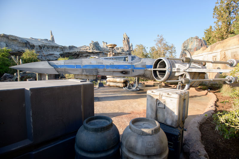 "Guests visiting Star Wars: Galaxy's Edge at Disneyland Park in Anaheim, California, and at Disney's Hollywood Studios in Lake Buena Vista, Florida, will encounter an X-wing Starfighter located at the Resistance Mobile Command Post. The X-wing is a nimble starfighter used in space combat first by the Rebel Alliance and now the Resistance. Its name comes from the ""X"" its four wings create when they're locked in attack position. (Richard Harbaugh/Disney Parks)"