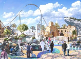 """Qiddiya Investment Company (QIC) staged a press conference on Monday, August 25, to discuss plans for the Six Flags theme park that will anchor its new entertainment destination outside the Saudi Arabian capital of Riyadh. Among other things, media representatives were told that this will be the largest and most expensive Six Flags park to date, featuring 28 rides and attractions. Twelve of those will set new world records, including the world's tallest, longest and fastest roller coaster. In addition, it will feature the world's tallest triple launch coaster, a tilting coaster, a wood-steel hybrid coaster, a record-breaking drop tower, multiple water rides, interactive dark rides and immersive experiences. Spanning 32 hectares (79 acres), Six Flags Qiddiya is set to open during Qiddiya's first phase in 2023. QIC promises that the wider 334 square-kilometre destination, built to a masterplan by the Bjarke Ingels Group (BIG), will become the Kingdom of Saudi Arabia's capital for entertainment, sports and the arts. As a closed joint-stock company wholly owned by Saudi's Public Investment Fund, QIC is not obliged to reveal the total investment cost. However, as a 'giga' project, the entire development is expected to cost the equivalent of """"multiple billion US dollars,"""" according to chief executive officer Michael Reininger. Six Flags will build and operate the theme park in a co-operative licensing agreement with QIC. """"Our vision,"""" says Reininger, """"is to make Six Flags Qiddiya a theme park that delivers all the thrills and excitement that audiences from all over the world have come to expect from the Six Flags brand, and to elevate those experiences with authentic themes connected to the location."""" Set against a dramatic backdrop of sandstone cliffs 45km from central Riyadh, the park's location is certainly distinctive. A Qiddiya Experience Centre currently stands next to the site, and construction is expected to begin in 2020. Qiddiya itself broke ground in April of l"""