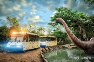 Super 78 ride Dino Tour trams going past animatronic dinosaur in rainforest