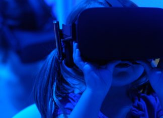 girl wearing VR goggles