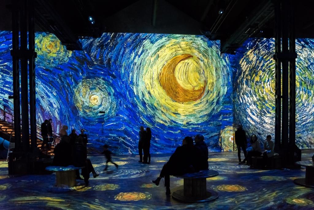 Atelier des Lumières Van Gogh exhibition people sitting