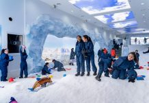 Children playing in powdered snow at Ice Now Frostland