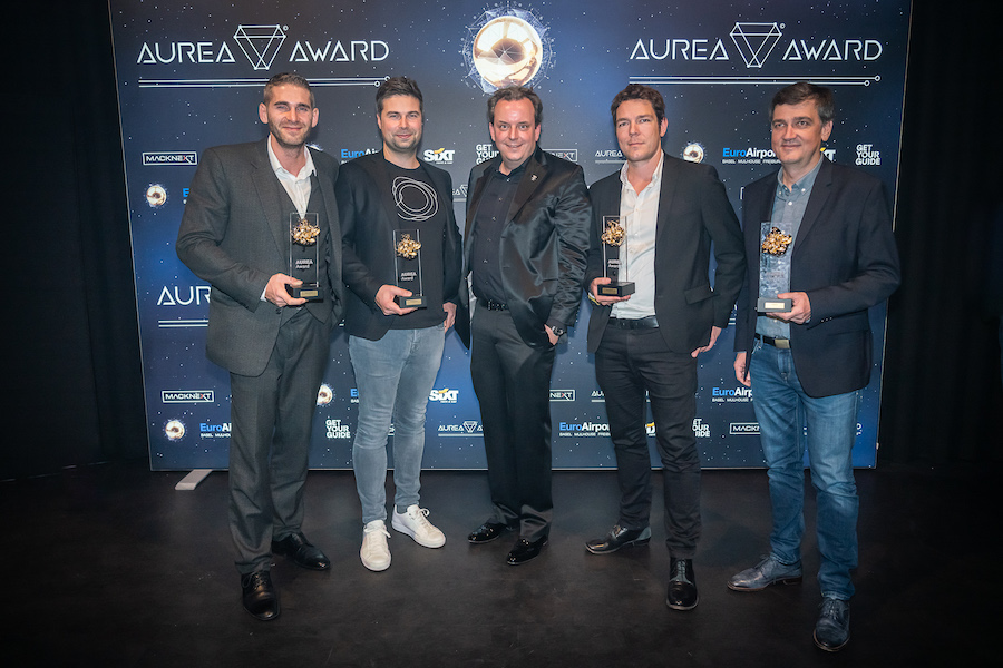 AUREA Award winners Sven Bliedung (Volucap), Nils Wollny (Holoride), Leif Arne Petersen (Hologate), Nino Sapina (Realcast) together with host Michael Mack (middle)